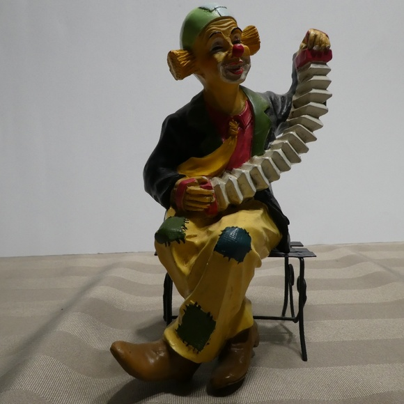 CLOWN figurine Musical Instrument sitting on bench